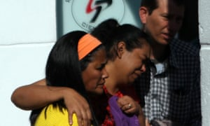 Relatives of victims of a series of street attacks arrive at the Legal Medical Institute in São Paulo state, Brazil, on Friday.