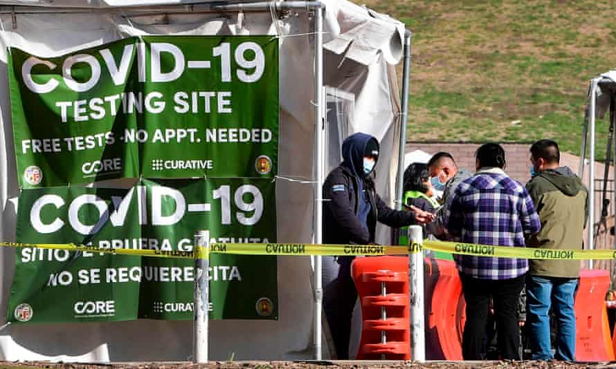 People arrive at a walk-up Covid-19 testing site in Los Angeles.