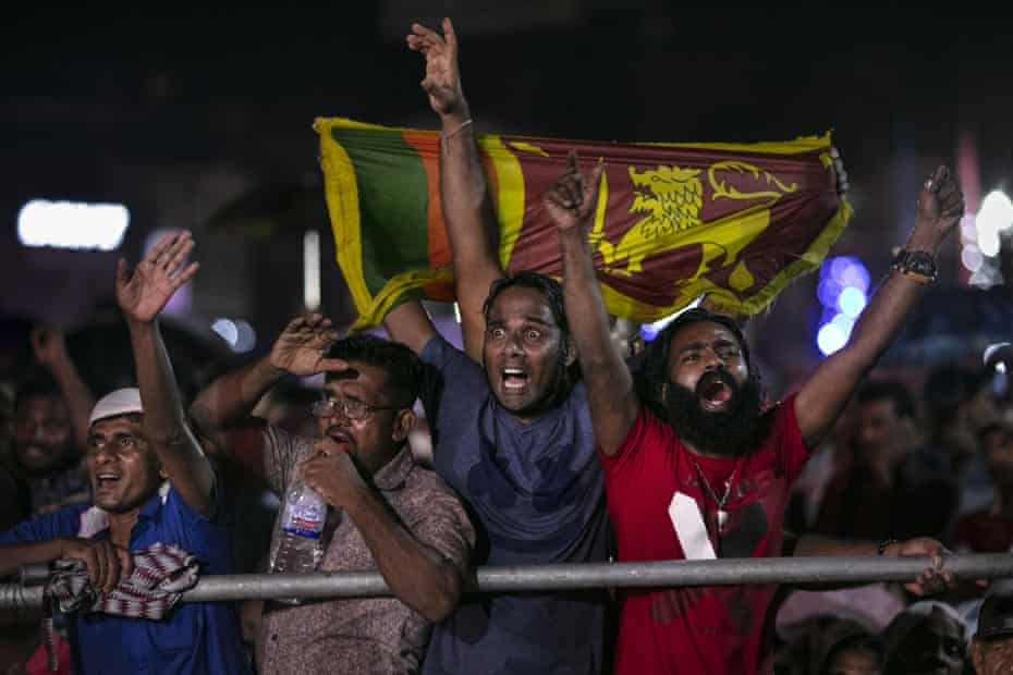 Supporters of the Sri Lankan presidential candidate Gotabaya Rajapaksa cheer during the last political rally before voting, 13 November