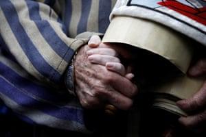 Oswiecim, Poland: Holocaust survivor Edward Mosberg holds the hand of his granddaughter