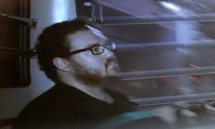 Rurik Jutting, pictured in November 2014 in a prison bus, has been convicted over the killings of two women in Hong Kong.