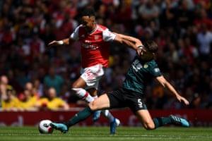 James Tarkowski of Burnley tackles Pierre-Emerick Aubameyang of Arsenal as The Gunners win 2-1 at Emirates Stadium.