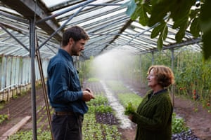 Jane and Harry in the greenhouse. They have been farming at Fern Verrow for 20 years, having moved to Herefordshire from London.