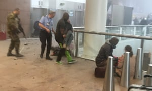 Passengers are treated after the bombing  of Brussels airport