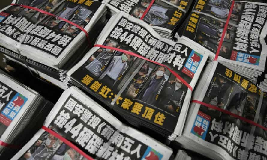 Copies of the Apple Daily newspaper are packed at a printing house in Hong Kong