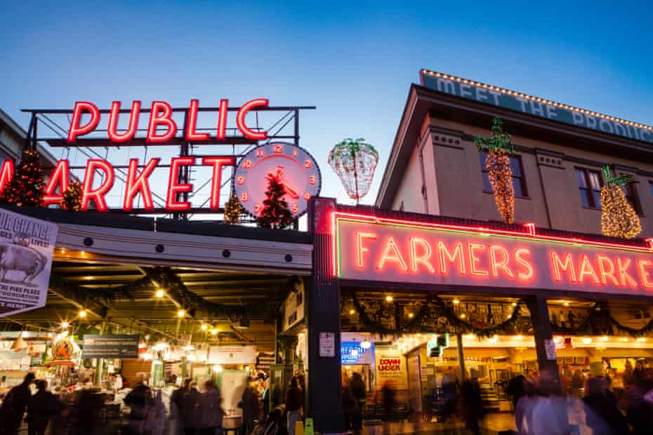 Seattle's Pike Place Market, with its familiar neon-lit clock and brass pig