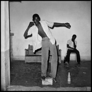 L'équilibriste, 1972 A young guy is showing off his balancing skills, probably to impress his friends. Next to him lays a dolo (ie millet beer) bottle, a popular drink in the Bobo region.
