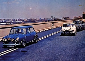 Still from The Italian Job showing Minis racing along roads.