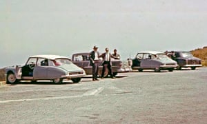 The four cars used to drive the students into France.