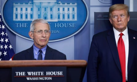 Anthony Fauci and Donald Trump at a White House coronavirus response briefing, 17 April 2020
