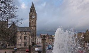 Rochdale town hall viewed from Packer Spout fountain in the grounds of St Chad's church.