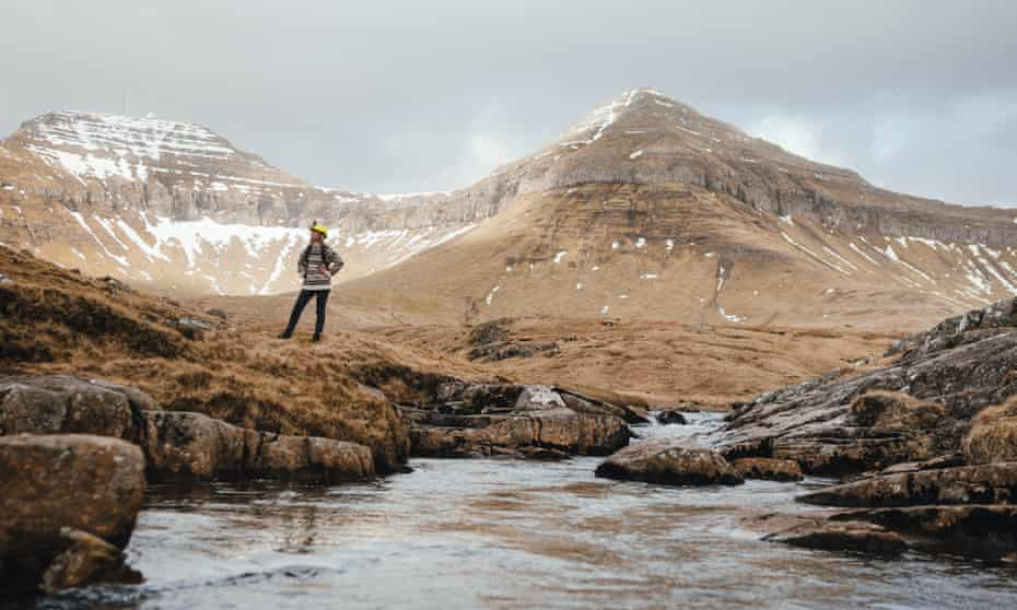 A Faroese local equipped with a video camera to show remote visitors around the islands.