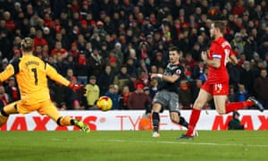 Shane Long evades the attentions of the Liverpool captain Jordan Henderson to fire Southampton's winner past Loris Karius.