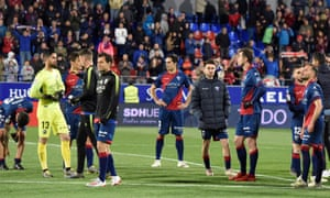 Huesca's players face up to relegation after losing to Valencia.