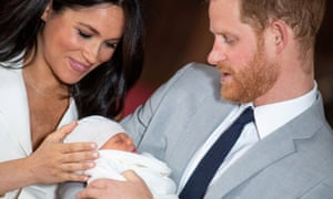 Prince Harry and Meghan, Duchess of Sussex with their baby son at Windsor Castle