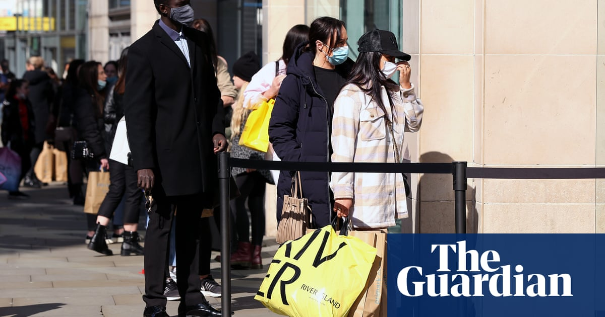 Shoppers surge back to high streets as Covid lockdown eases in England