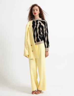model wears blazer, £169, and trousers, £113, gestuz.com. Sweater, £39.99, mango.com. Heels, £65, dunelondon.com. Earrings, £50, luvaj.com