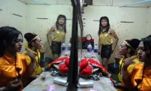 Nepalese transgender people get ready for a performance to mark the International day against homophobia in Kathmandu, Nepal.