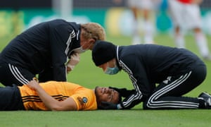 The medics assess Romain Saiss of Wolves.