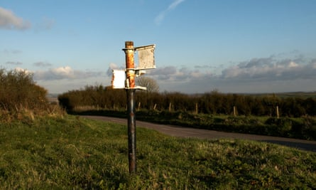 remains of signpost on Eggardon hill in Dorset devoid of any places names.