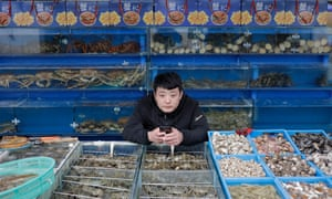 A vendor waits for customers at a market in Beijing