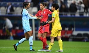 Carli Lloyd expresses sympathy to Thailand's Sukanya Chor Charoenying and Taneekarn Dangda after Tuesday's game