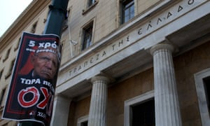 German finance minister Wolfang Schäuble is depicted on a no poster outside Bank of Greece in central Athens.