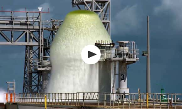 Nasa douses rocket launch pad with two million-litre water fountain – video