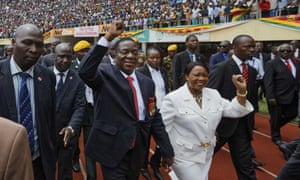 Emmerson Mnangagwa and his wife Auxillia arrive at the presidential inauguration ceremony in Harare on Friday.