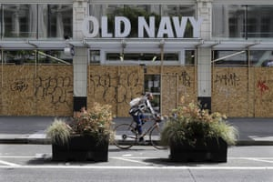 A boarded up and closed Old Navy clothing store in downtown Seattle. The US unemployment rate hit 14.7% in April, the highest rate since the Great Depression.