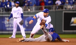 New York Mets center fielder Juan Lagares (12) steals second base ahead of the tag by Kansas City Royals second baseman Ben Zobrist.