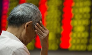 A Chinese investor in front of a screen displaying share prices in Nanjing, China.