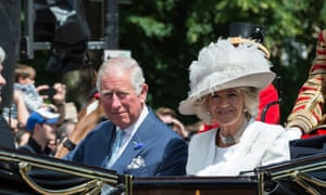 Charles and Camilla taking part in a royal procession along The Mall.