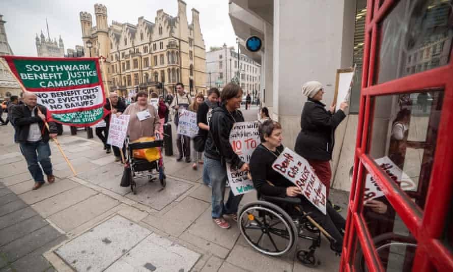 Members and supporters of Disabled People Against Cuts (DPAC) protesting in September 2014