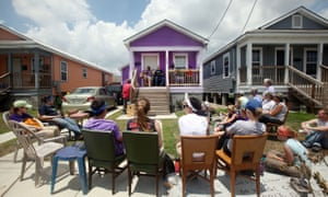 People gather to listen to music in front of a home at the Musicians Village