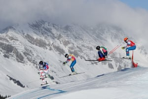 Austria's Marcus Plank, Russia's Artem Bazhin, Sweden's Erik Wahlberg and Russia's Andrei Gorbachev compete in the final of the freestyle skiing men's ski cross.