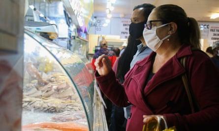 People search for fish for Good Friday, 9 April 2020, Porto Alegre, Rio Grande do Sul ,Brazil.