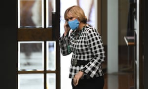 MP Zali Steggall wears a face masks as he enters the House of Representatives at Parliament House in Canberra.