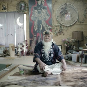 Ainu elder Haruzo Urakawa in his home. Kamuy Mintara, meaning `Playground of Gods`, is a Cise, a traditional Ainu home, that 75 years old Haruzo Urakawa built by himself in the mountains outside of Tokyo. Here, he lived as close as possible to the traditional Ainu lifestyle which, as a child in Hokkaido, he had learned from his father.