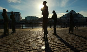 Statues commemorating the Great Famine in Ireland along the river Liffey in Dublin.