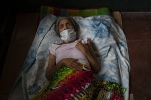 An elderly woman recovers in an evacuation centre