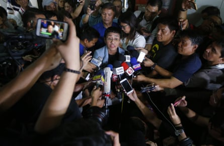 Maria Ressa, center, talks to the media after posting bail at a Regional Trial Court following an overnight arrest