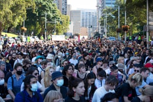 Protesters sit down in Park Street during the Stop Black Deaths in Custody protest in Sydney