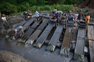 Artisanal gold mining in Mgusu, Geita, Tanzania, where about 4,000 people mine, crush and wash under hazardous conditions