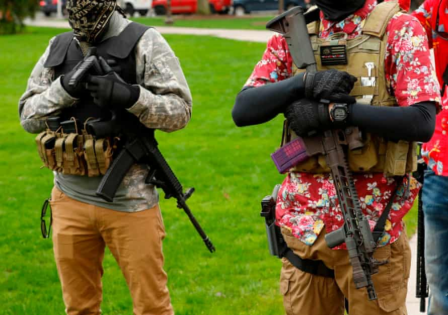 Armed protesters take part in a rally in Lansing, demanding the reopening of businesses. Whitmer has been was repeatedly attacked for her tough coronavirus lockdown.