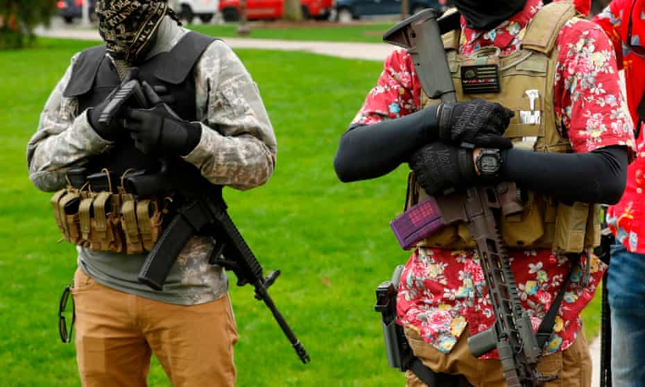 Armed protesters take part in an 'American Patriot Rally' on the steps of the Michigan state capitol in April.