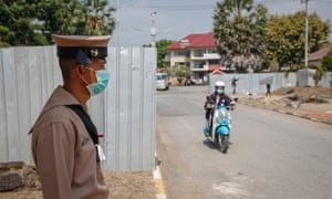 A Thai Royal Navy officer stands at the entrance of the residence which will house Thai nationals soon to be evacuated from Wuhan. Thailand is scheduled to evacuate more than 100 Thais who will remain quarantined for two weeks