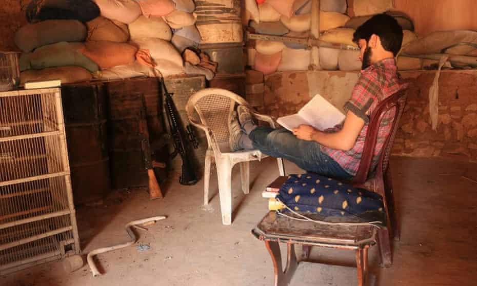 Omar Abu Anas reading on the frontline