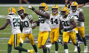 The Packers celebrate a crucial fumble recovery