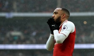 Alexandre Lacazette considers a late missed chance.